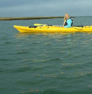 PJ Cook kayaking in Cape Cod.
