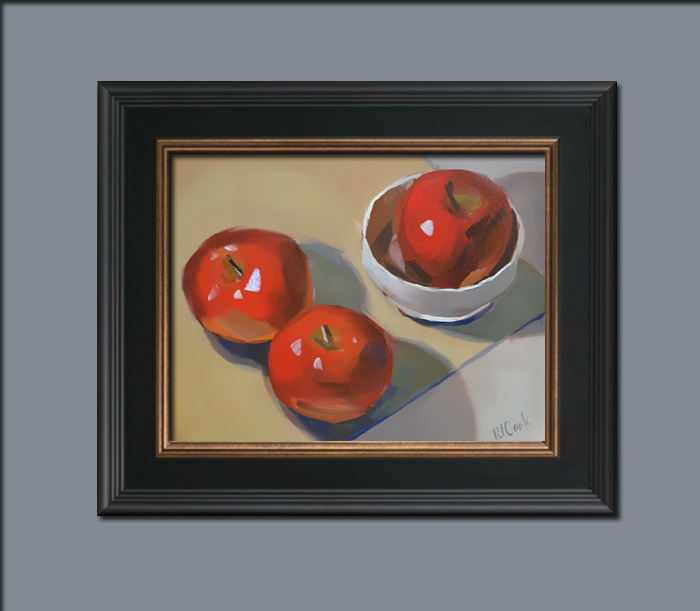 still life with apples oil on canvas with a dark wood frame