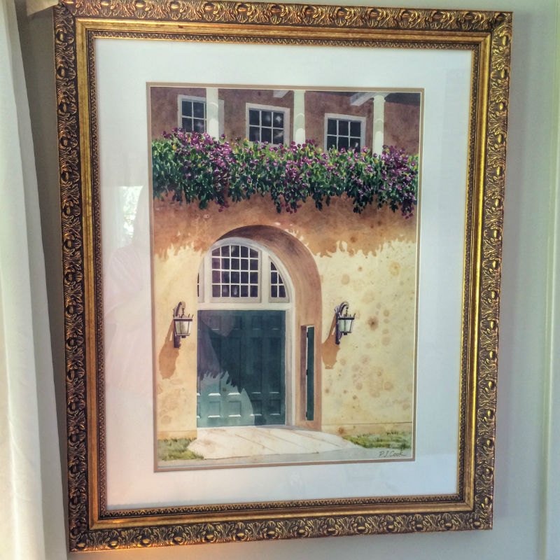 watercolor of green door of a carriage house